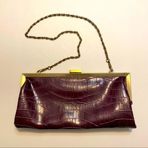 Plum faux snakeskin clutch with chain strap